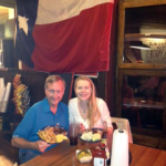 dave enjoying a meal with texas flag on wall