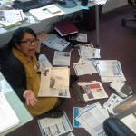 jackie sitting on the floor surrounded by piles of papers