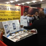 train by cell booth at a conference
